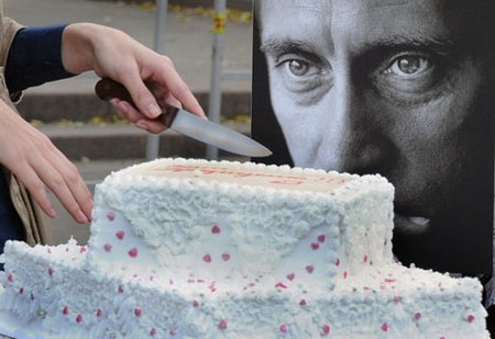 An activist of 'Army of Putin' cuts a birthday cake in honor of Vladimir Putin, Moscow, October 7, 2011.