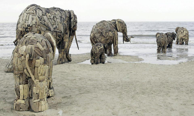 Recycle Wood Sculptures Land Art by Andries Botha http://bit.ly/V1wSKL