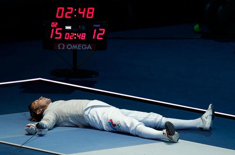 Ruski sportista na Olimpijadi u Londonu © Andrew Medichini/AP