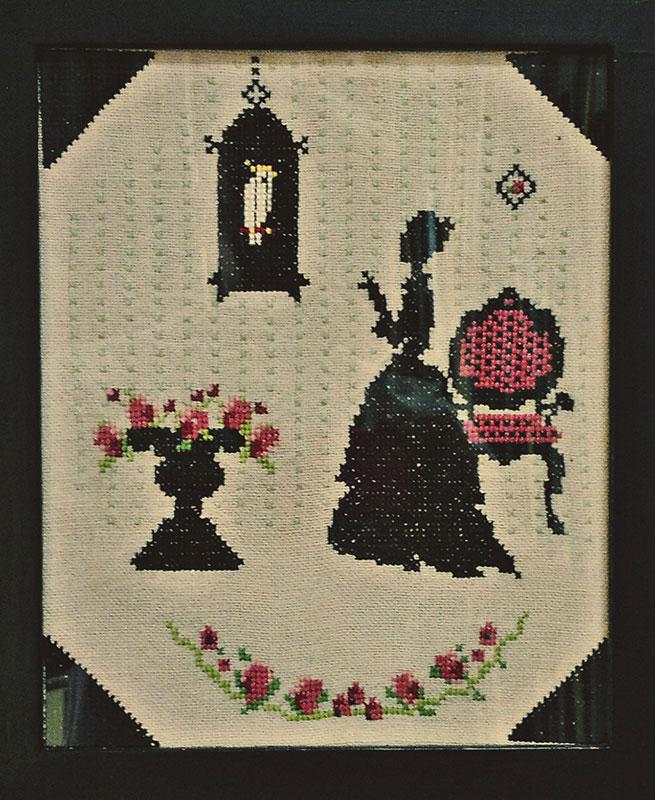 goblen sa ženom i krletkom