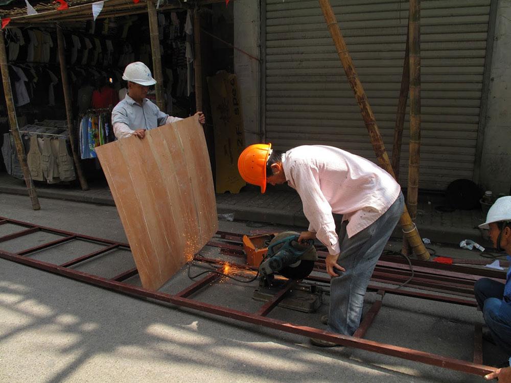 dva radnika na ulici Šangaja