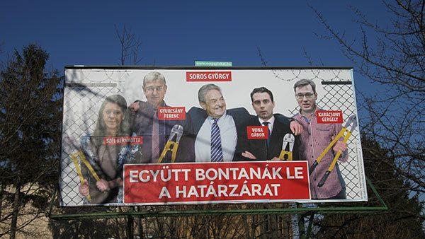 Antiimigrantski plakat u Mađarskoj: Soros i 'njegovi' seku žičanu ogradu na granici