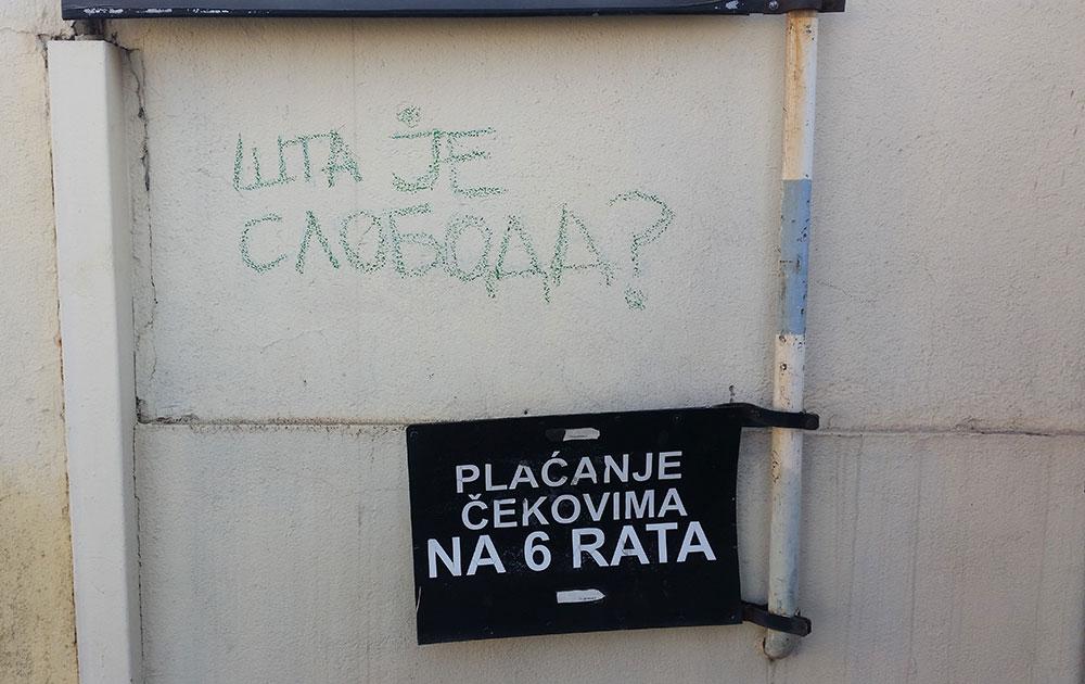Natpis na zidu: Šta je sloboda?