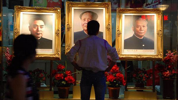 Uramljeni portreti vođa KP Kine