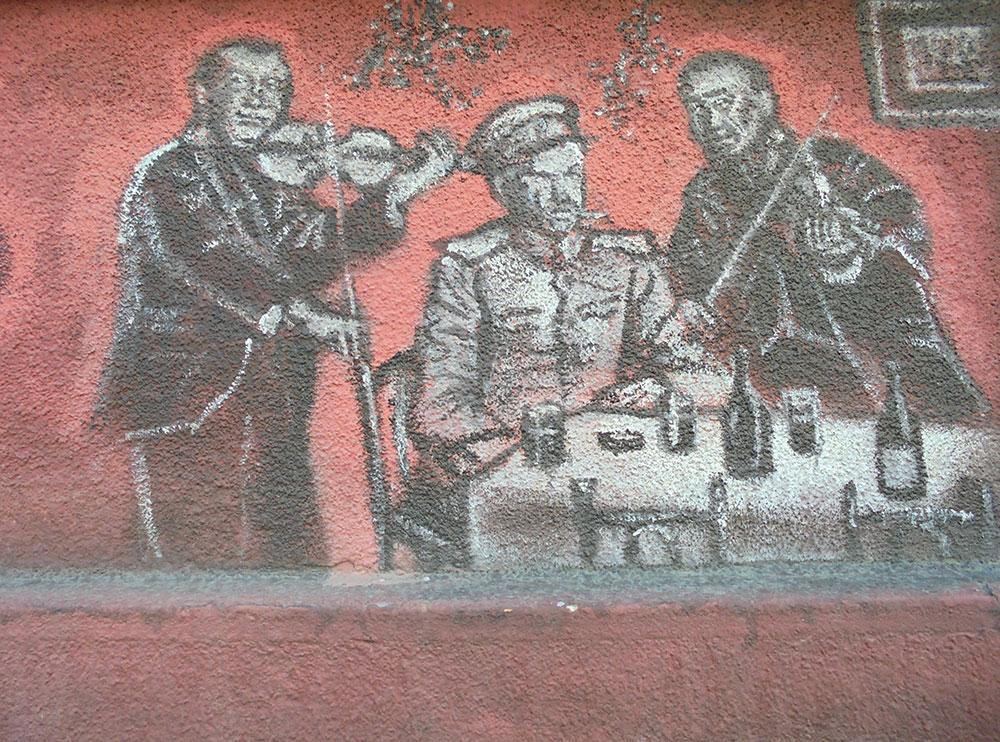mural na kojem su nacrtani svirači u kafani