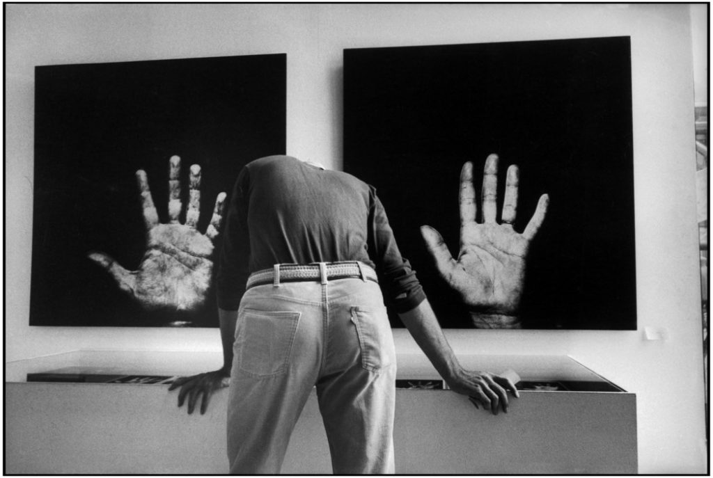 """FRANCE. Paris. 1977. Pompidou Centre, National Museum of Modern Art. """"Paris - New York"""" exhibition. Photographs from the """"Handshow """" by the French artist Robert FILLIOU and the US artist Scott HYDE showing the hands of 24 artists."""
