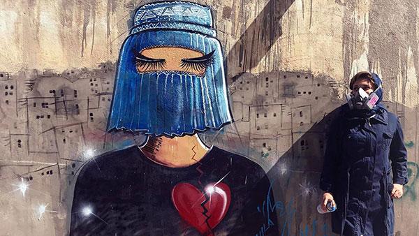 Shamsia Hassani pored svog grafita